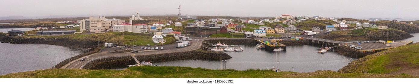 Panoramic view of Stykkishólmur, Iceland from the top of Súgandisey Cliff on an overcast day.
