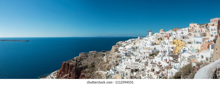 Panoramic View With Iconic Windmills Of Santorini