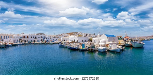 Panoramic view to the idyllic fishing village Naousa with moored traditional fishing boats on the island of Paros, Cyclades, Greece