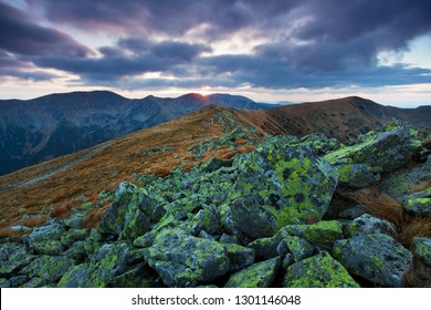 Panoramic view of idyllic mountain scenery in the Alps with stones on a beautiful windy day in atumn, panoramic view of mountains at border of Austria and Swiss, Europe