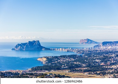 """Panoramic view of Ifach Rock Natural Park or """"Penon de Ifach"""" and Calpe city in Spain. View from Cumbre del Sol mountain, also known as """"Puig Llorenca"""""""