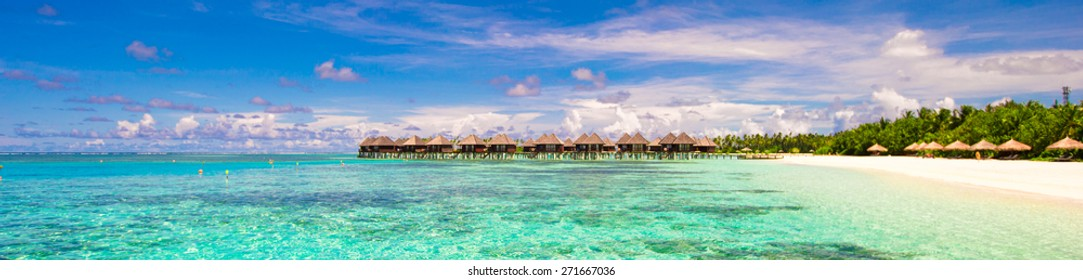 Panoramic view of iidyllic tropical beach with white sand and perfect turquoise water
