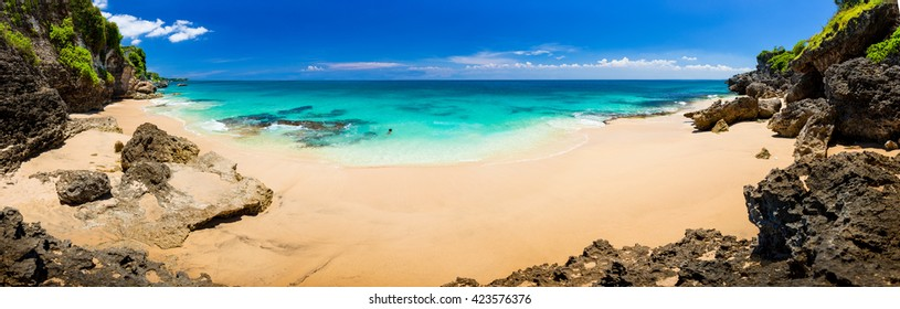 Panoramic view of iidyllic tropical beach with yellow sand and perfect azure clean water / Indonesia, Bali