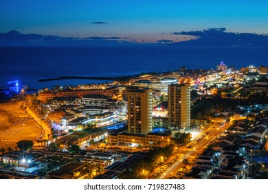 Panoramic view of the Illuminated Las Americas at night with clubs, hotels and bars in Tenerife island, Spain