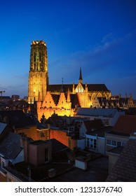 Panoramic view of the illuminated old town of Mechelen and the Saint Rumbold's Cathedral in the early evening, Belgium