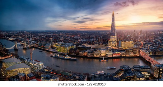 Panoramic view to the illuminated skyline of London, United Kingdom, during sunset time with sun and rain