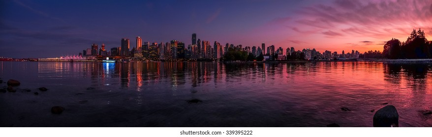 Panoramic view of impressive Vancouver skyline and harbor with beautiful red sunset glow, British Columbia, Canada