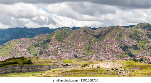 Panoramic view at the Inca ruins of Sacsayhuaman  and houses in Cusco at the background.