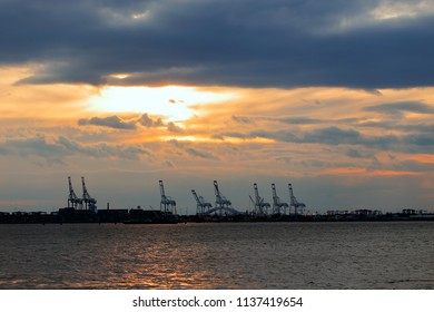 A panoramic view of an industrial harbor right next to the bay.