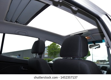 Panoramic view inside car and sunroof hatch with glass of car.