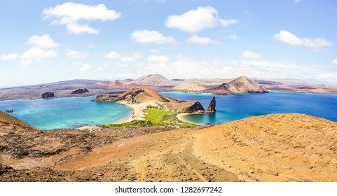 """Panoramic view of """" Isla Bartolome """" at Galapagos Islands archipelago - Travel and wanderlust concept exploring world nature wonders around Ecuador - Vivid filter with warm bright color tones"""