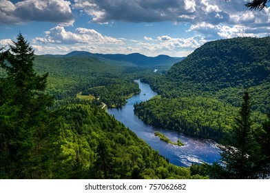 Panoramic view of Jacques Cartier river national park on a warm and sunny summer day, Quebec, Canada