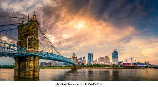 Panoramic view of John A. Roebling Suspension Bridge over the Ohio River and downtown Cincinnati skyline