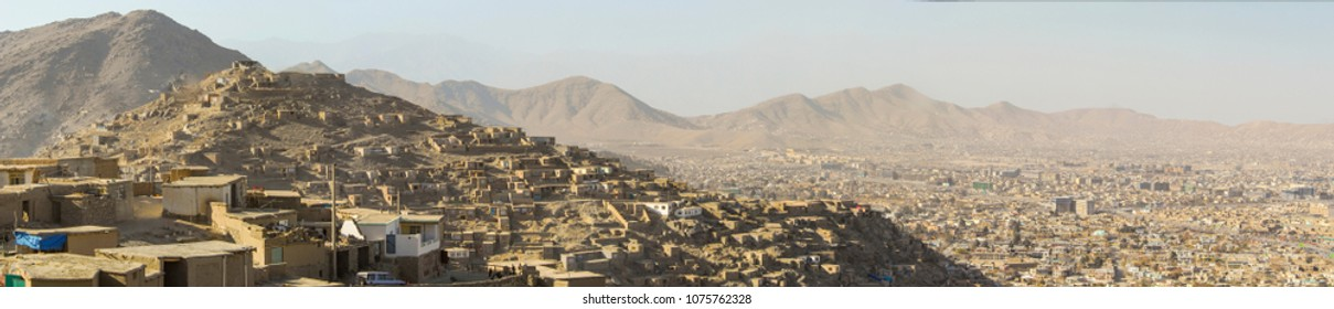 A panoramic view of Kabul with its many informal settlements on the hillsides with houses built of mud providing shelter to a large population of displaced persons