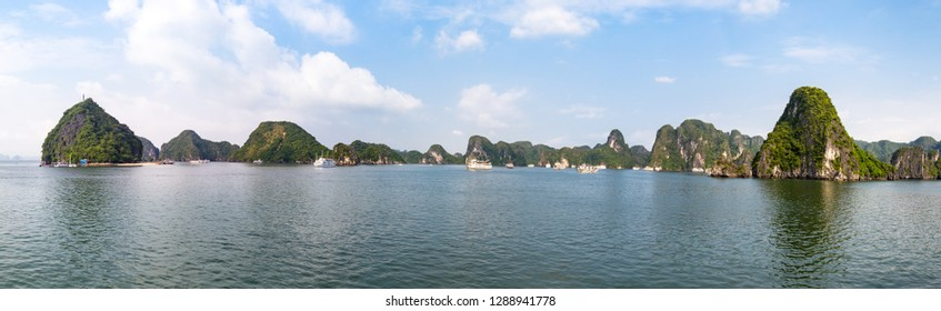 Panoramic view of karst formations in Halong Bay, Vietnam, in the gulf of Tonkin. Halong Bay is a UNESCO World Heritage Site and the most popular tourist spot in Vietnam