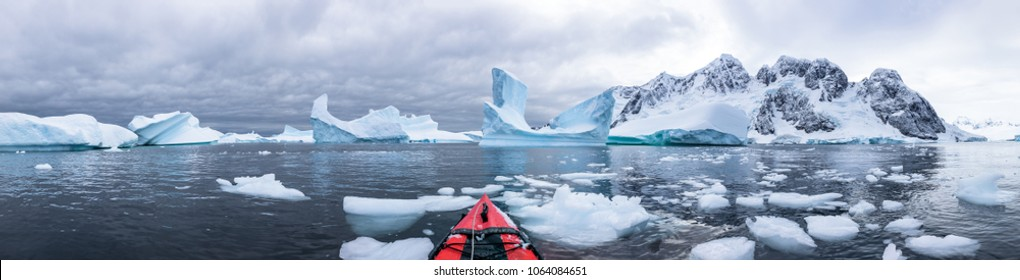 Panoramic view of kayaking in the Iceberg Graveyard in Antarctica, incredible POV panorama with sea and ice, Antarctic Peninsula