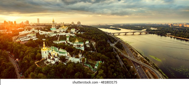 Panoramic view of Kiev Pechersk Lavra at sunset. Aerial view. General view of the city and the Dnipro river and beautiful sunset sky.