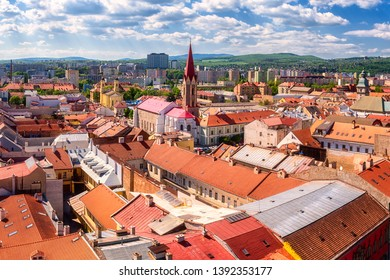 Panoramic view of Kosice Old city from St. Elisabeth Cathedral, scenic daytime cityscape with streets, red tiled roofs of medieval buildings and blue cloudy sky, urban skyline, Slovakia (Slovensko)