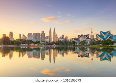 Panoramic view of Kuala Lumpur city waterfront skyline with reflections and beautiful morning sky, Titiwangsa Park, Malaysia. Big size