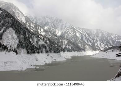 The panoramic view of Kurobe Dam in winter (Hydropower plant). The Kurobe Dam or Kuroyon Dam is a variable-radius arch dam on the Kurobe River in Toyama Prefecture, Japan.