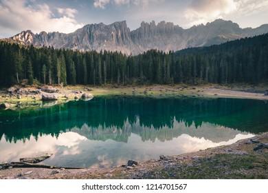 Panoramic view of Lago die Carezza with Latemar mountain range,