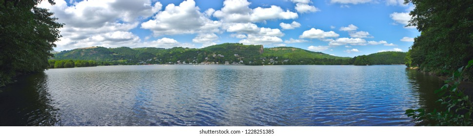 panoramic view of Lake Aydat in Auvergne, Puy de Dome. With chain of volcanoes in the background