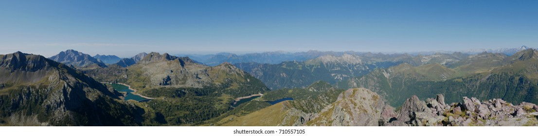 Panoramic view of lake Colombo basin and dam on the Bergamo Alps, northern Italy