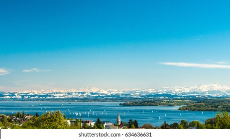 Panoramic view of lake of Lake Constance with Swiss Alps in background