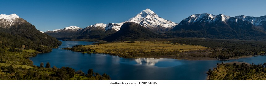 Panoramic view of the lake district and the Andes mountain range with a snowed high peak on the background.