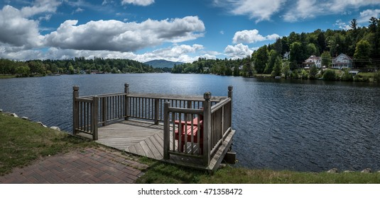 Panoramic view of Lake Flower at Saranac Lake, NY, in the Adirondacks on a sunny summer day