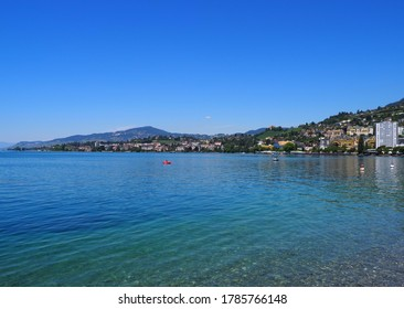 Panoramic view of Lake Geneva and european Montreux city in canton Vaud in Switzerland, clear blue sky in 2017 warm sunny summer day on July.