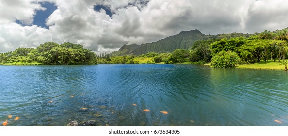 A panoramic view of the lake at Hoomaluhia Botanical Gardens in Kaneohe on Oahu, Hawaii