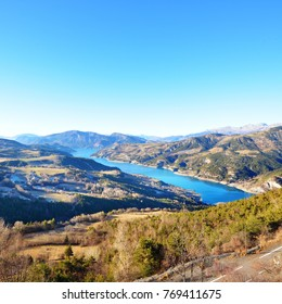 Panoramic view of lake Lac de serre-poncon in French Alps on a clear day