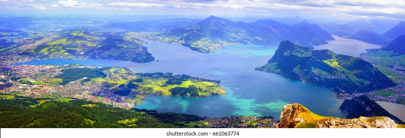 Panoramic view of Lake Lucerne with Lucerne town, Kussnacht, Burgenstock resort and Rigi Mountain, swiss Alps mountains, Switzerland