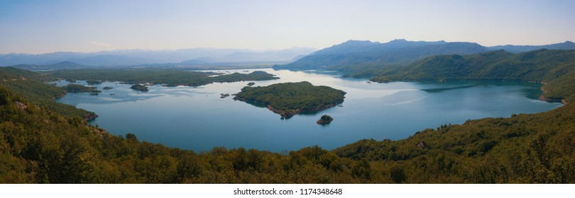 Panoramic view of the lake in the mountains with many small islands. Montenegro, Salt Lake near town of Niksic