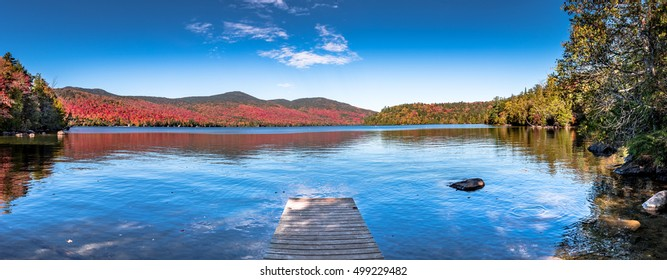 Panoramic view of Lake Placid in the Adirondacks on a bright sunny day with colorful autumn foliage