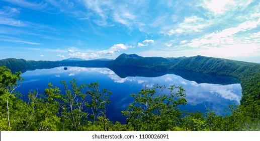panoramic view of a lake reflecting sky. Lake Mashu,Akan National Park,Japan.