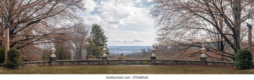Panoramic view from a landscaped terrace at Grey Towers National Historic Site in Milford, Pennsylvania, looking southeast toward New Jersey on a mild winter day