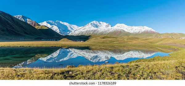 "Panoramic view of Lenin Peak from Tulpar Kol lake - Kyrgyz Pamir Mountains - Kyrgyzstan and Tajikistan border- Central Asia called ""Roof of the World"""
