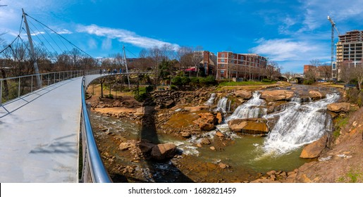 A panoramic view of the Liberty Bridge crossing the Reedy River Falls in Greenville, South Carolina