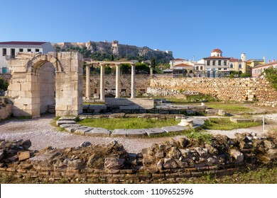 Panoramic view of the Library of Hadrian, Athens, Greece. It is one of the main landmarks of Athens. Scenic panorama of Athens centre with Ancient Greek ruins. Acropolis of Athens in the distance.