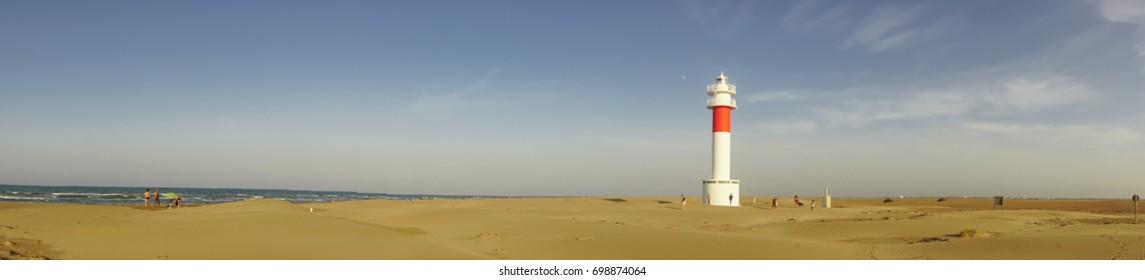 """Panoramic view of Lighthouse """"el Far del Fangar"""" on Delta de l'ebre natural park, tarragona, Catalonia, Spain."""