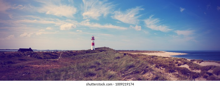 Panoramic view of the lighthouse List east on the island sylt, Vintage filtered style