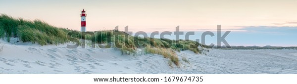 Panoramic view of a lighthouse standing at the coast of Sylt, North Sea, Germany