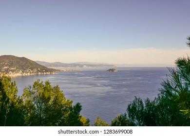 Panoramic view of the Ligurian coast with Alassio, Albenga and the Gallinara Island from the cape of Capo Mele, Andora, Liguria, Italy