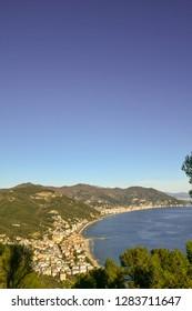 Panoramic view of the Ligurian coast with Laigueglia and Alassio from Capo Mele cape, Andora, Liguria, Italy