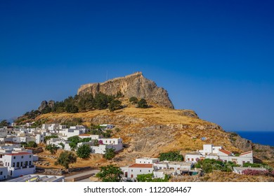 Panoramic view of Lindos castle in Rhodes island, Dodecanese, Greece. It is a historical castle and one of the most famous tourist destination in South Europe.