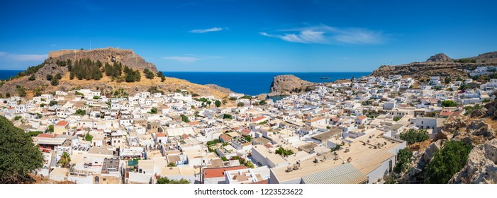 Panoramic view of Lindos village with Acropolis and Mediterranean Sea in background (Rhodes, Greece)