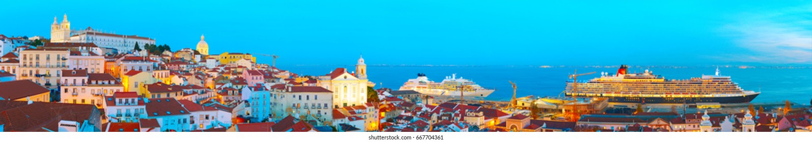 Panoramic view of Lisbon Old Town and sea port with luxury cruise ships. Portugal