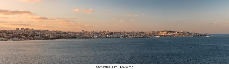 Panoramic view of Lisbon and the Tagus river at sunset, Portugal